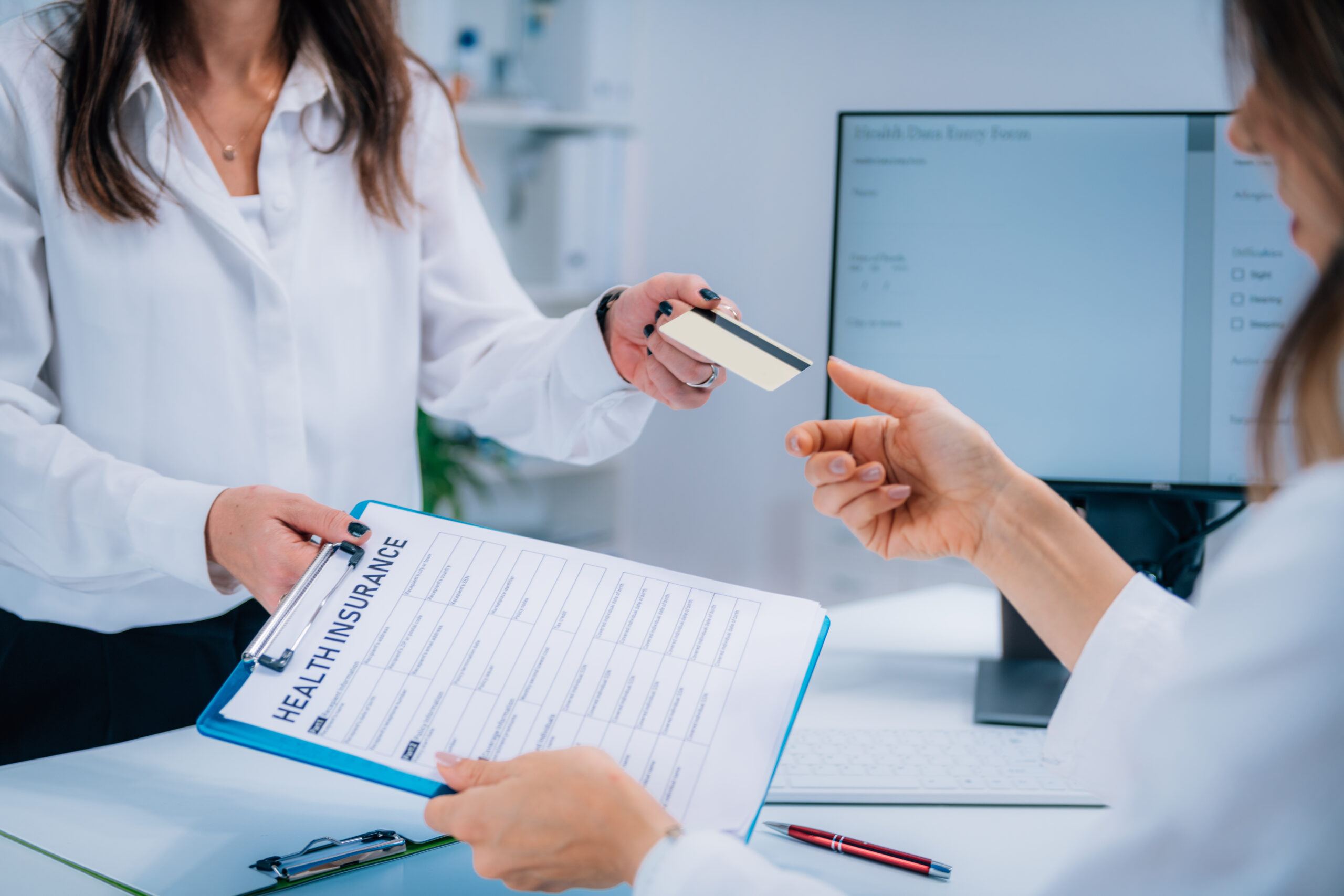 Woman Paying Health Insurance with Credit Card
